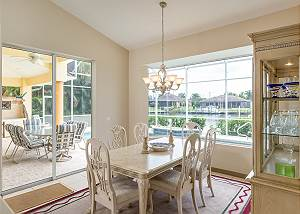 Dining table eats 6 and affords views of the pool and canal.