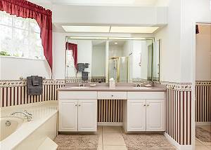Deep soaking tub and double sinks in the master bathroom.