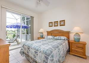 The 2nd bedroom offers a full bed and access to the lanai.
