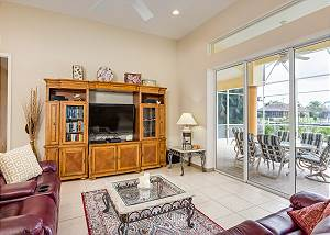 High ceilings and large sliding glass doors make the living room feel open and airy.