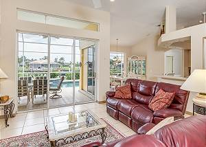 Plush leather seating and lots of natural light in the living room.