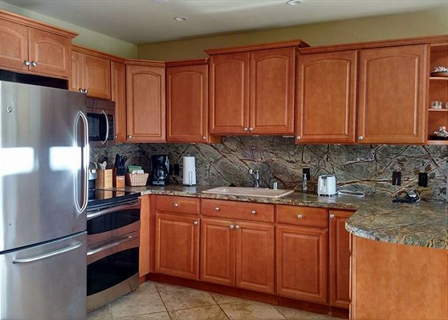New Honey Maple cabinets with Rain Forest Marble counter tops, new stainless appliances.