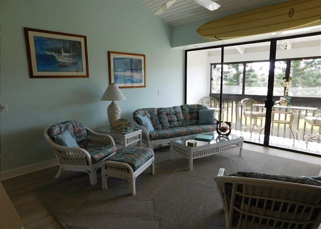 Comfortable living room with great views of the 1st hole on the Fazio Golf Course. Ceiling fan