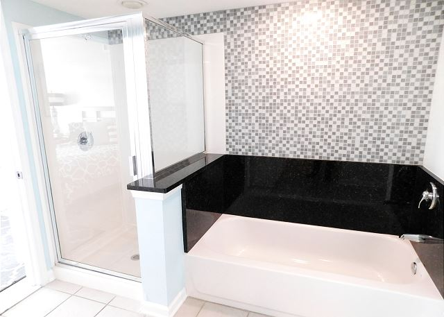 Waterfront Bedroom #1 Ensuite Bathroom with Tub and Separate Shower
