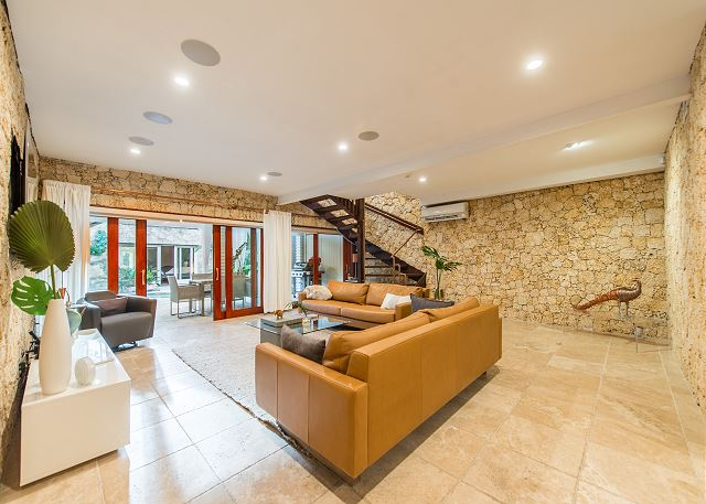 Fantastic living/ family room adjacent to the kitchen and stunning outdoor areas.