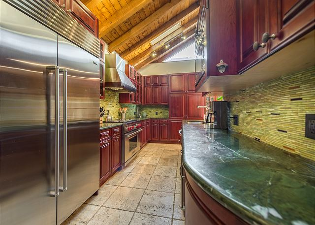 Fully stocked kitchen with top of the line appliances.