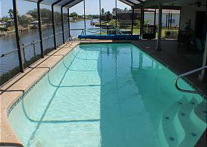 Private heated pool, screened in Lanai, water front.