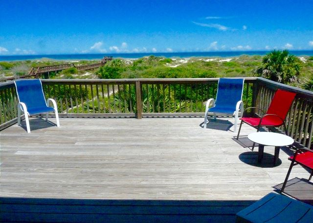 Spacious oceanfront deck with unobstructed views over the dunes of the Atlantic Ocean.