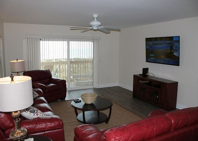 Living room with ocean view balcony.  Flat screen TV.
