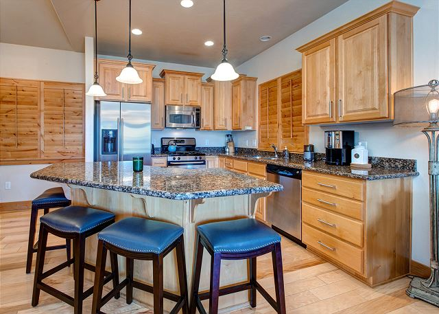 Fully Equipped Kitchen with Granite, Stainless and Bar Seating