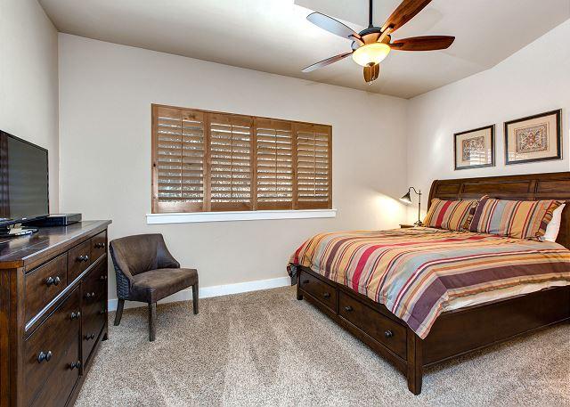 Master Bedroom with Queen Bed, TV, Ceiling Fan and En Suite Bathroom