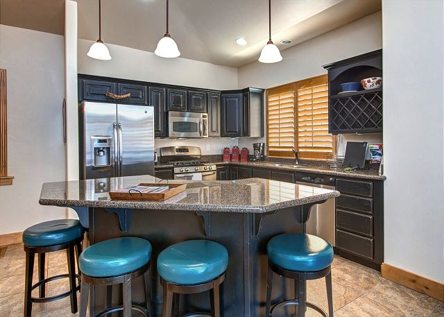 Fully Equipped Kitchen. Bar Area Seats 4
