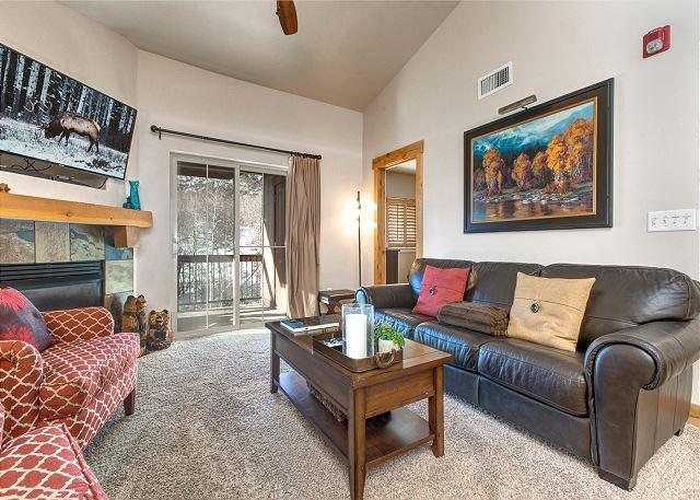 Main Living Room with Sleeper Sofa, TV, Gas Fireplace and Balcony