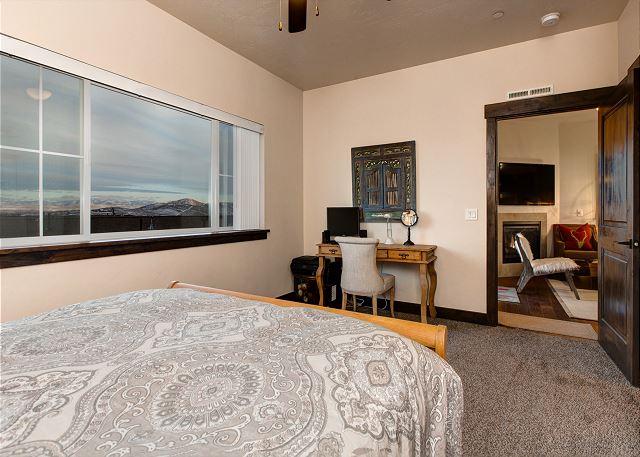 Master Bedroom with Queen Bed, Computer, Desk and En Suite Bathroom
