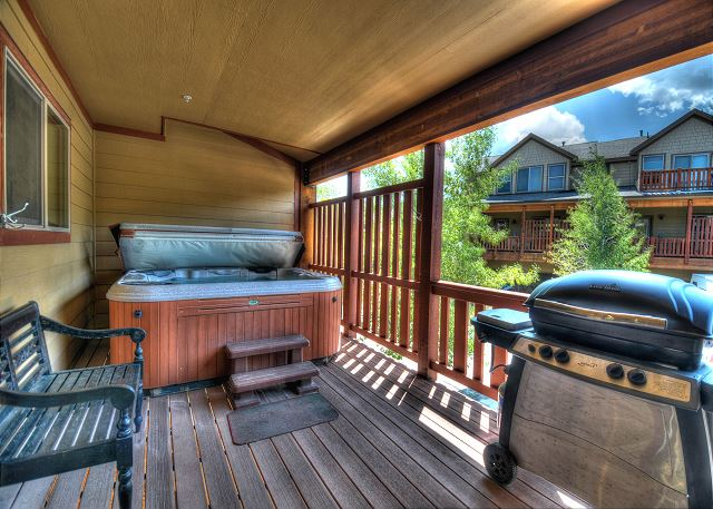 Next to the kitchen is a deck with a hot tub for relaxing after a fun day in town and a gas BBQ