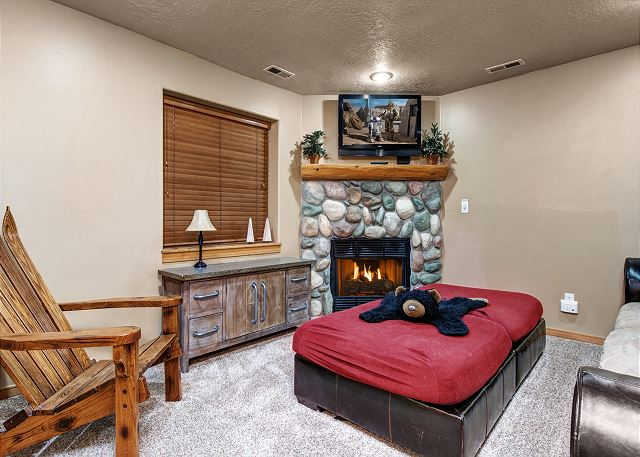 Lower Level Den with Comfortable Seating, Gas Fire Place and TV