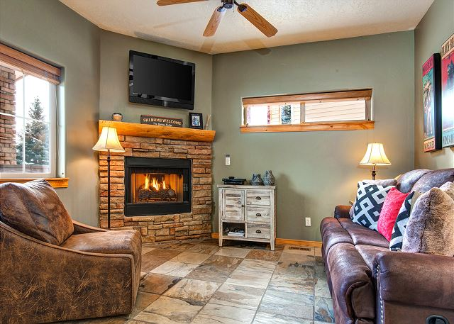 Main Level Living Area with Comfortable Seating, Gas Fireplace and TV