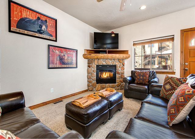 Main Level Living Room with Large HD Smart TV and Gas Fireplace
