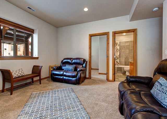 Lower Level Livingroom/Den with Large HD Smart TV and Gas Fireplace. Large Floor Space for Queen Air Mattress