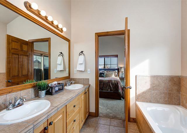En Suite Master Bathroom with Double Sink Vanity, Separate Shower and Soaking Tub