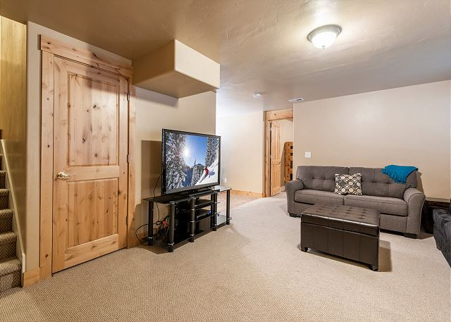 Downstairs Family Room with Sleeper Sofa and TV with Amazon Firestick