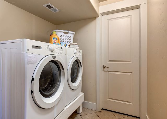 Lower Level Laundry Room with HE Washer and Dryer on Easy Access Platform