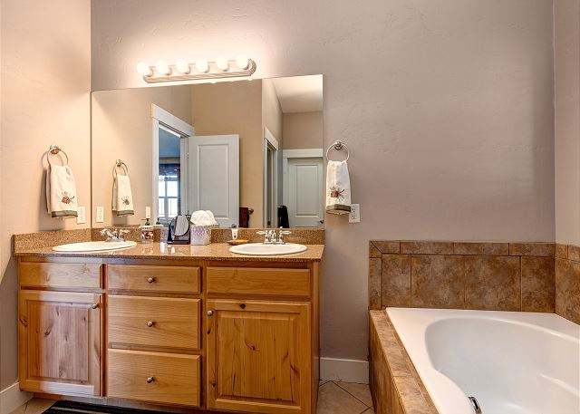 Upstairs En Suite Master Bathroom with Separate Soaking Tub and Shower