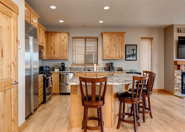 Fully Equipped Kitchen with High-end Stainless Appliances and Bar Seating for 4