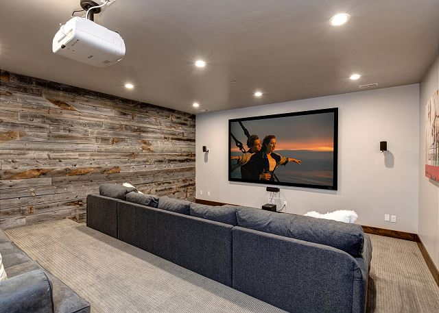 Private theater room with high end projector and screen. Plenty of seating with the large sectional sofa and extra sofa bed.
