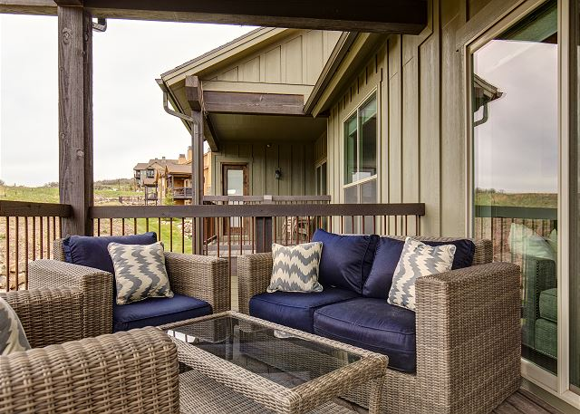 Main level balcony with comfortable seating and BBQ