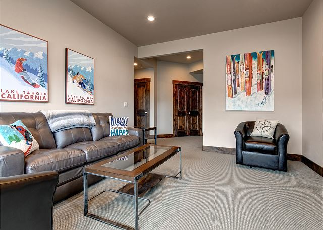Lower level living room w/TV, gas fireplace and sleeper sofa