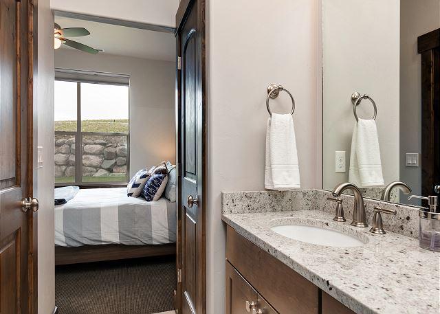Lower level queen master with en suite bathrooms