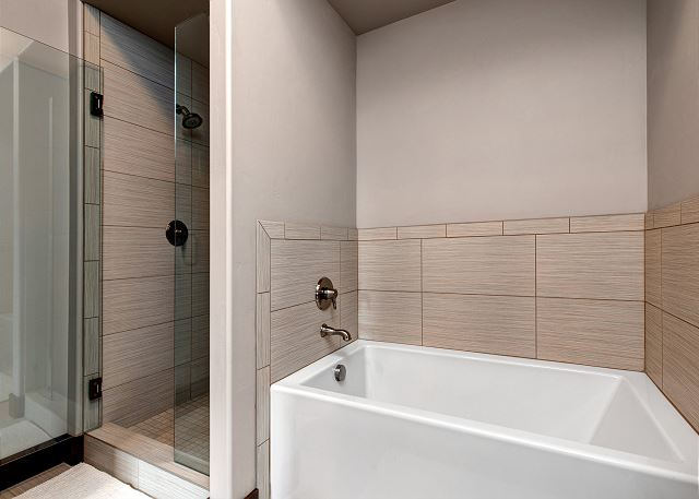 Lower level queen en suite bathroom with separate tub and shower