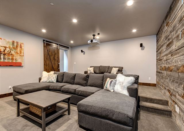 Private theater room with large sectional plus sofa bed