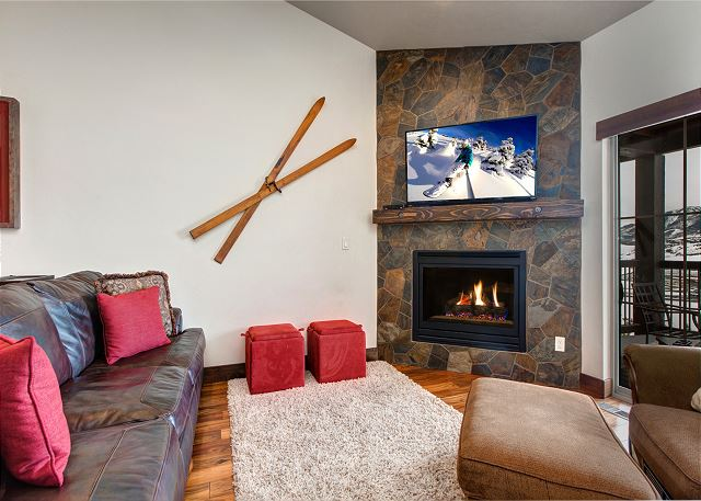 Main Living Room with TV, Gas Fireplace, Comfortable Seating and Balcony with Seating and Views!