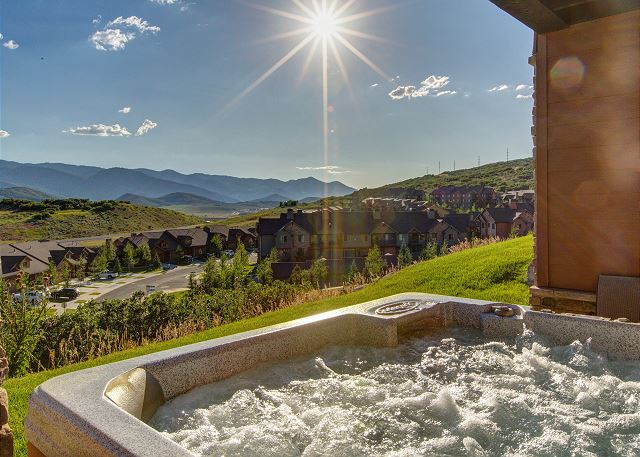 Take in the amazing views and watch the sun set in this large private hot tub.