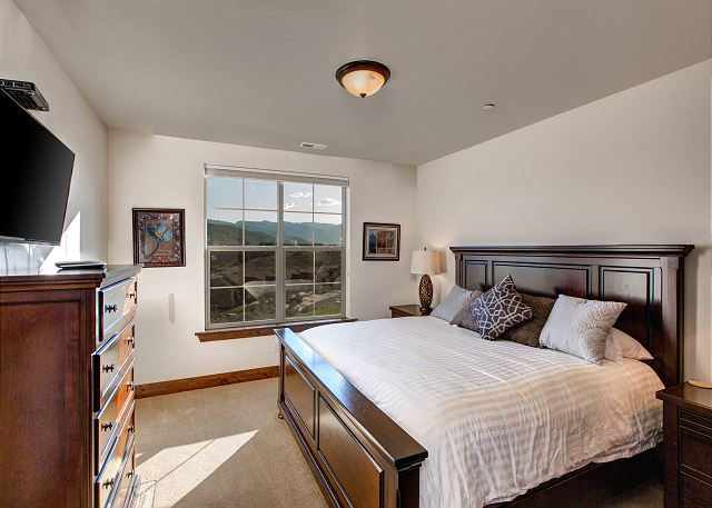 "Main Level Master Bedroom - King-Sized bed, 42"" HD TV, ceiling fan, attached private bathroom **Summer View"