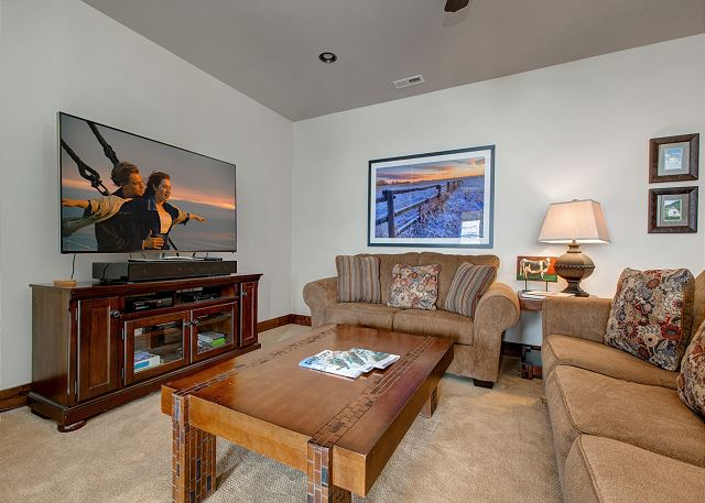 Lower Level Family Room with Large TV and Sleeper Sofa