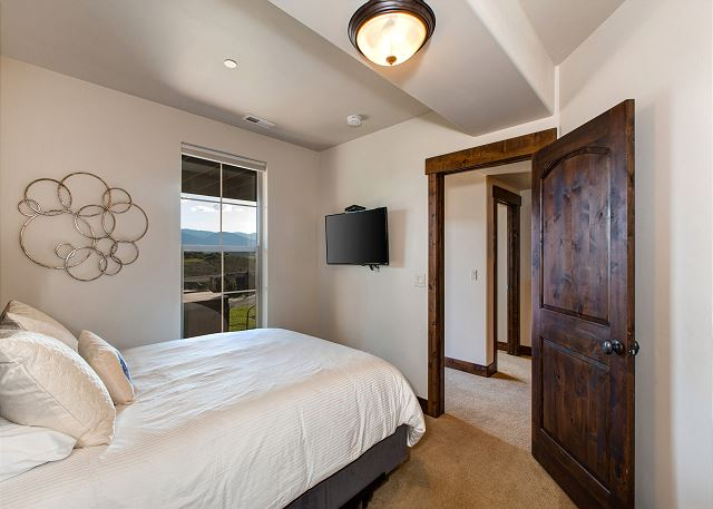 "Lower Level Guest Room - King-sized bed, 42"" HD TV and shared bathroom (with tub/shower combination) *Summer Views"