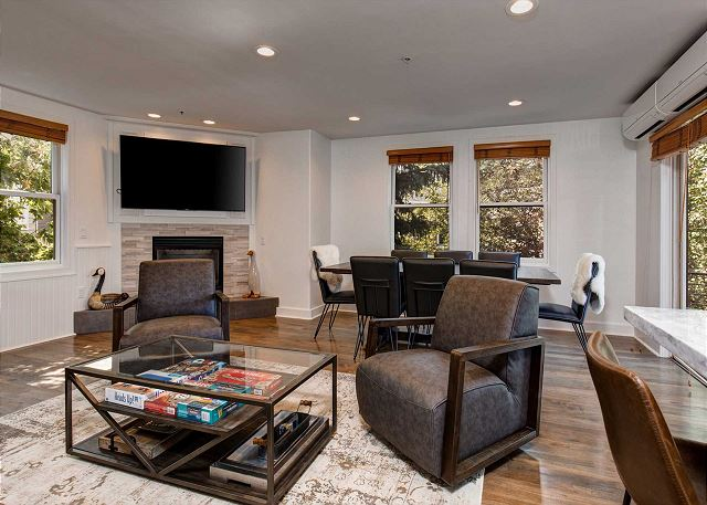 "Main Living Room with 65"" Smart TV, Gas Fireplace and Large Dining Table - Open and Bright!"
