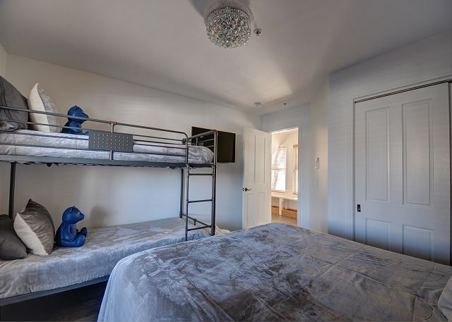 Lower Level Bedroom with Queen Bed and Twin over Twin Bunk Bed - Plus TV and walk-out to Hot Tub Patio