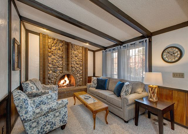 Main Level Living Room with Large Stone Gas Fireplace and NEW Furnishings!