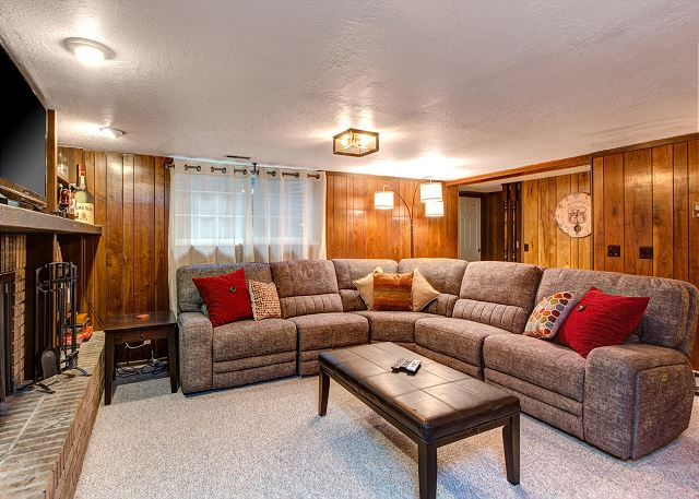 Lower Level Gathering Room with Real Wood Burning Fireplace, TV, NEW Sectional Sofa and Bar Area