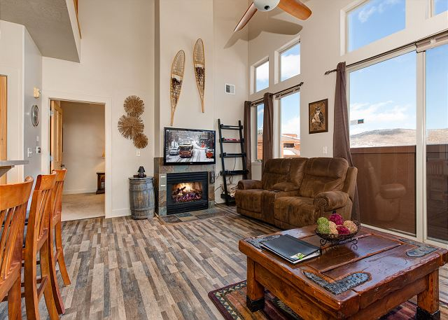Main Living Area with Large, Tall Windows for Beautiful Mountain Views and Light - Gas Fire Place and TV