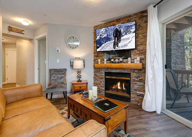 Living Room with 55inch TV, Gas Fire Place and Sleeper Sofa
