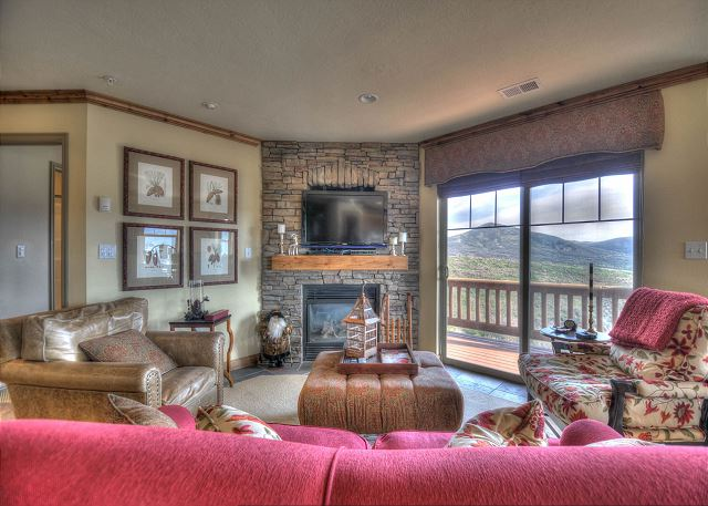 Living Room with TV, Gas Fireplace, Balcony and Views!