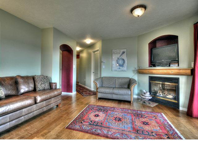 Open and Spacious Living Area with Sleeper Sofa, TV, Gas Fireplace and Balcony with Views.
