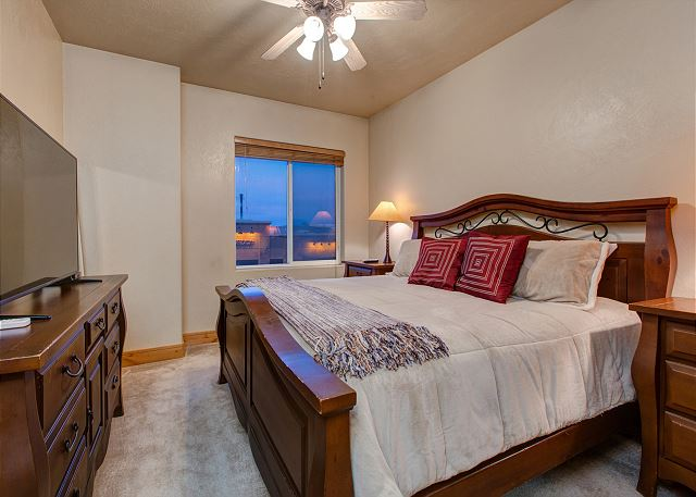 Master Bedroom with Large TV, En Suite Bathroom and King Bed