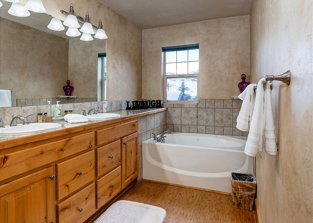 Upstairs Master En Suite Bathroom with Dual Sink Vanity and Separate Tub and Shower