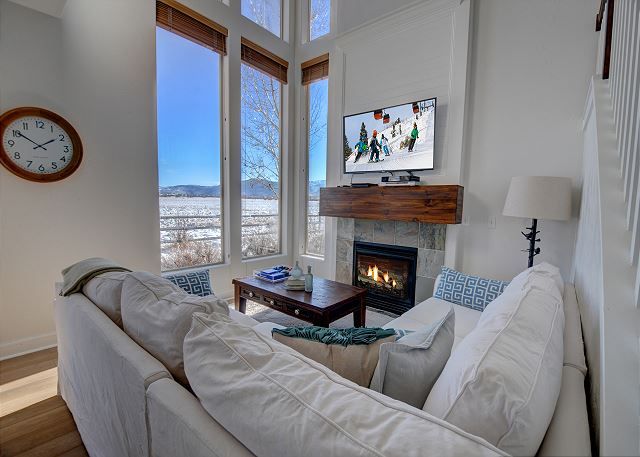 """Main Living Area with a 65"""" TV and PlayStation 4 (+games), Gas Fireplace and Large Windows w/Unobstructed Views!"""